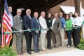 Cutting the ribbon for the State Employees' Credit Union 4-H Learning Center were LaHay; Dr. Jim Clark, chair, N.C. 4-H History and Learning Center Committee; McInnis; Linton; Lonnie McCaskill, SECU Advisory Board member; Marshall; Yoder; Keith Russell, director of Camp Millstone; Brooke Schmidt, president of the N.C. 4-H Development Fund Board of Directors; McAuley; and Killian Davis.