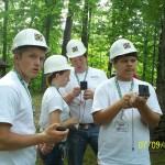 Tucker, Hannah, Caleb and Logan practice using compasses.