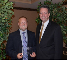 4-H Agent accepts award