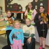 Junior Appalachian Musicians (JAM) fiddle class. L-R: front row: Autumn Hinton, Pam Dengler (instructor), back row: Doma Hacskaylo, Grace Morris (youth instructor), Tekoah Collini