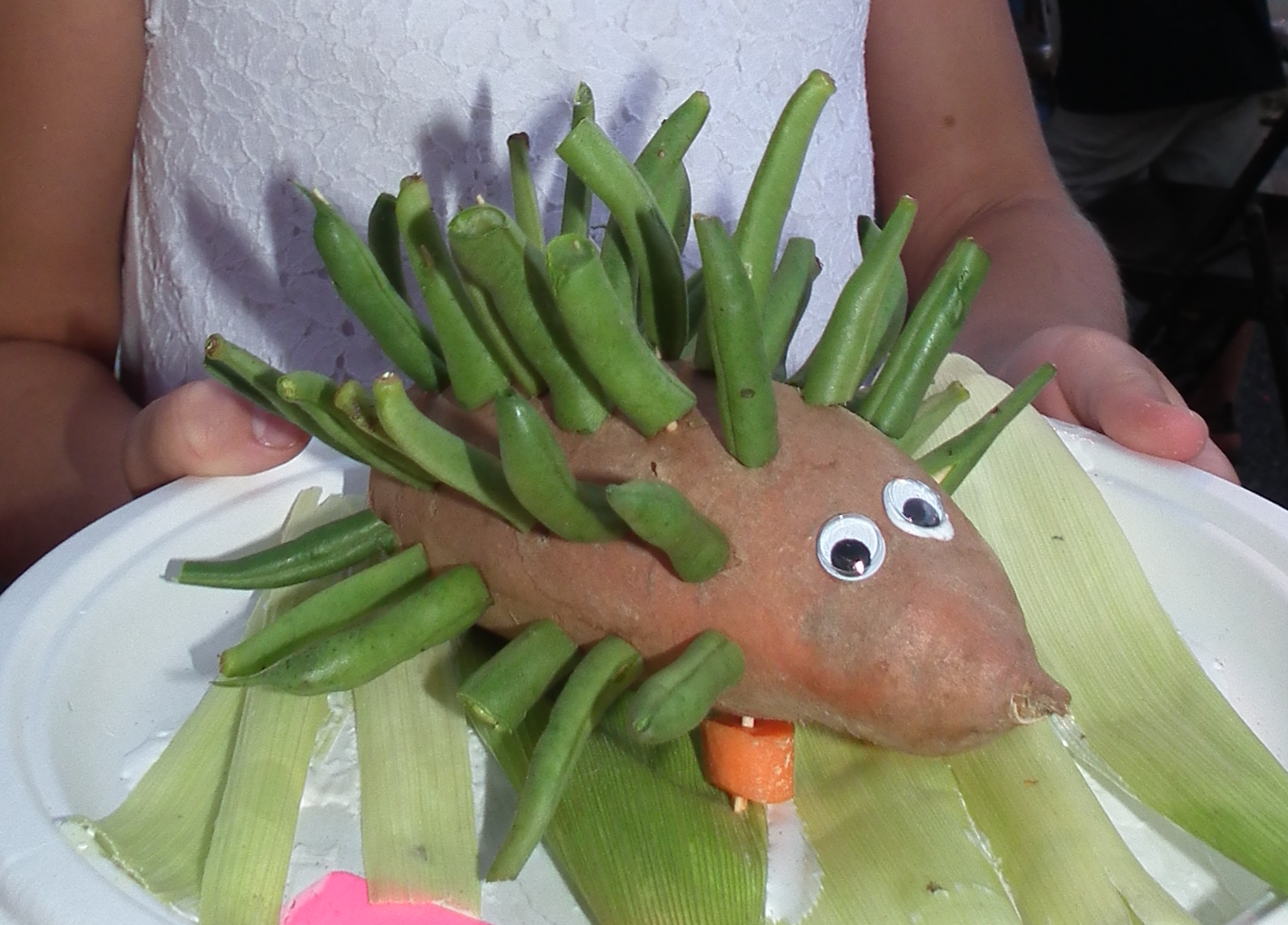 Veggie porcupine with a sweet potato body and green bean spines.