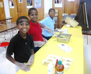 Students making a cabbage slaw