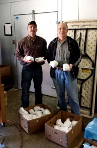 Extension agent Ross Young on the left and and Allen Bradley, director of a local food bank called Beacon of Hope. This was a delivery of 200 lbs of venison in October 2013.
