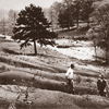 """""""Old worn-out soils"""": Soil erosion was a high-priority agricultural issue that Extension addressed early on. Here, an agent and farmer inspect a seriously eroded field in the late 1920s."""