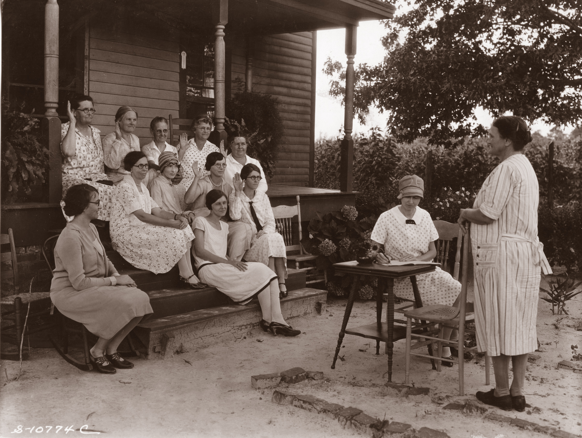 Mrs. Joe Kelly presides at the Watha Home Demonstration Club meeting. The picture, set in rural Pender County, was probably taken between 1925 and 1930.