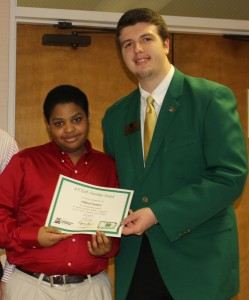 J'Khari Jones, Northampton County 4-H member,  receives the 4-H Youth Volunteer Award from Michael Chaney, State 4-H Council Vice President at the Northampton County 4-H Achievement Night Red Ball