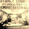 Agricultural club members staff a Stanly County Poultry Demonstration Booth in about 1922. Over time, club members would come to be known as 4-H'ers.