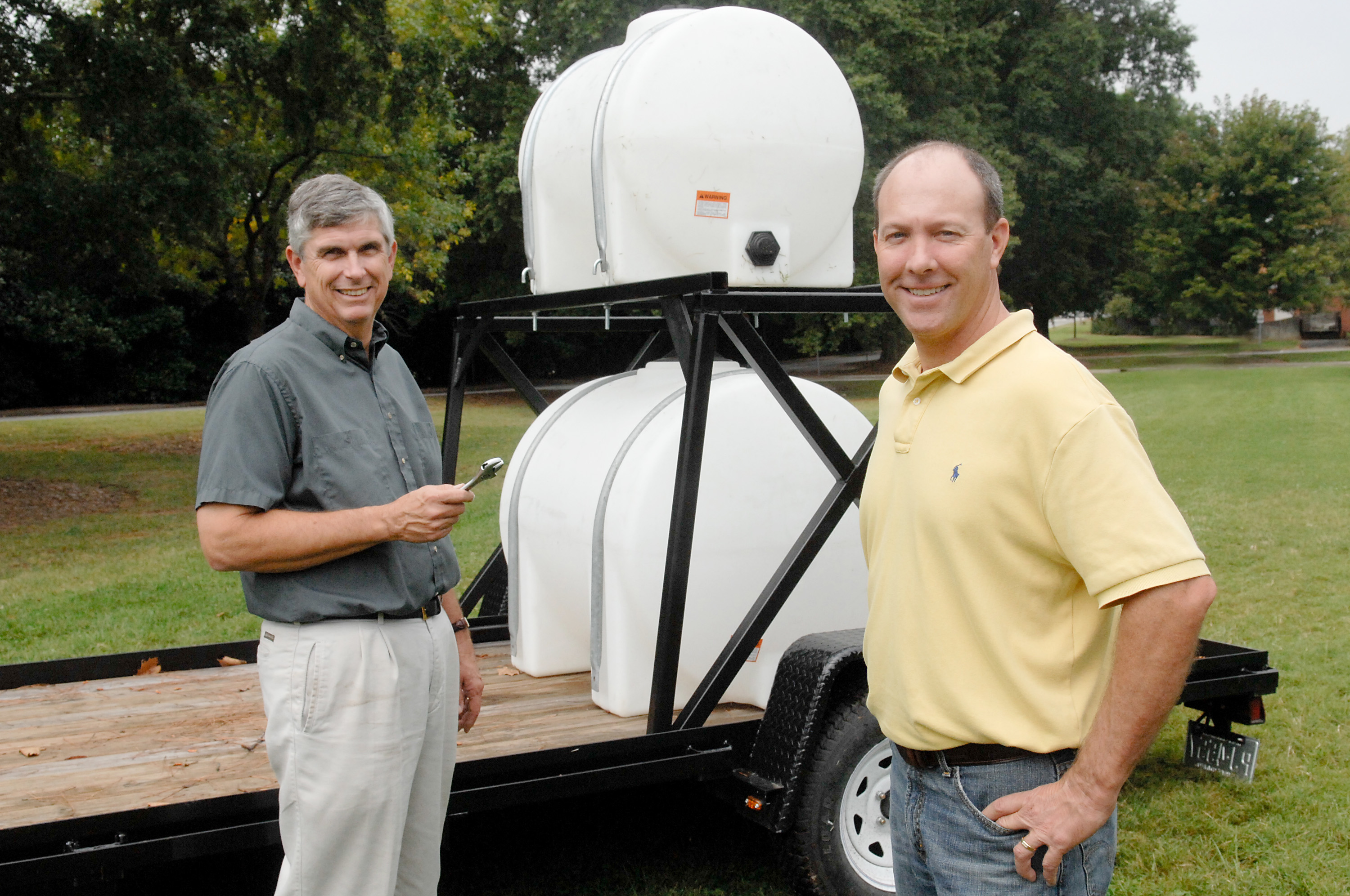 (L-R) Dr. Gary Roberson and Rod Gurganus lead the effort to develop more functional, portable hand-washing stations for N.C. growers. They are developing two units (a larger and smaller version) with funding from the N.C. Rural Economic Development Center's Agricultural Advancement Consortium. *The unit pictured is not a completed product.