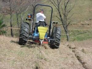 grower on tractor prepares field