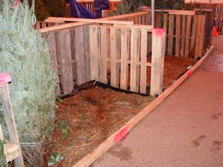 Water and mulch contained by pallet, 2x4,  and plastic structure