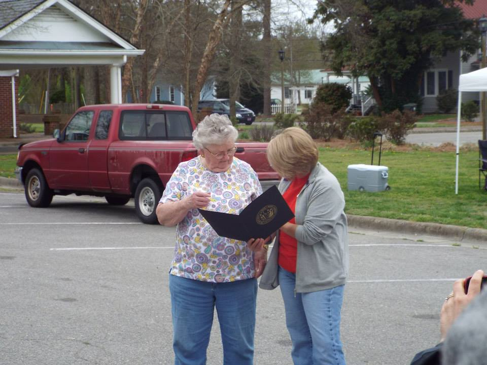 Rebecca Castello, Hertford County Cooperative Extension Administrative Assistant presents Peggy Lowe with Murfreesboro Community Hunger Ministry a certificate and pin from NC Governor Pat McCroy as the Hertford County recipient of the Governor's Volunteer Award for 2014.