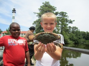 Cloverbud Water Day Camp participants show off their catch at Lake Mattamuskeet.