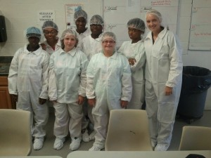 Career Day Camp Youth follow careful food safety regulations on their visit to Rose Acres Egg Farm.