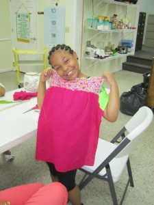 Sew What? Day Camp participant, Jada White, shows off her work.