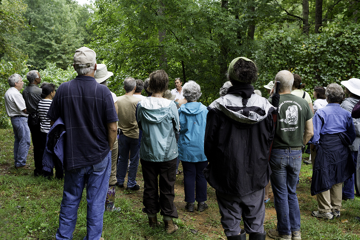 Folks gathered in the orchard to learn from grower Wynn Dinnsen.