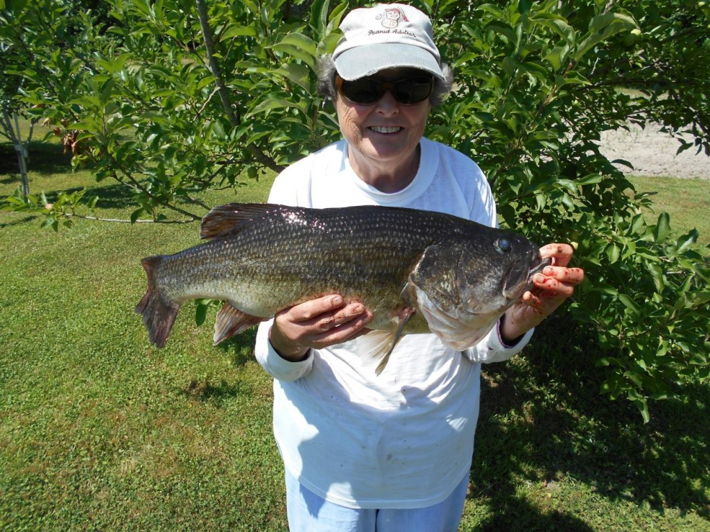 David's mom holding a large bass