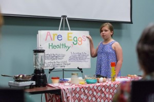 Isabelle Mazure, Coastal Explorers 4-H Club member, demonstrates how to cook a delicious, nutritious crepe.