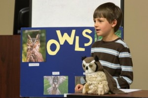 Quinn O'Keefe, Shamrock 4-H Club member, teaches the audience about the unique trails of owls.