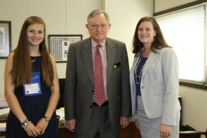photo of 4-H'er, representative and 4-H agent