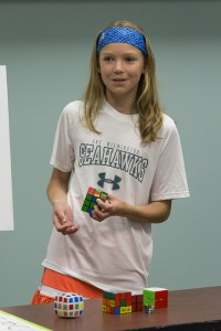 Elena Berg demonstrates how to solve a 2x2 Rubik's cube.