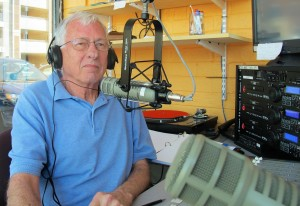 Harold Johnson, show host, behind the mic at WCOM 103.7 FM [Photo: Lise Jenkins, EMGV in Durham county]
