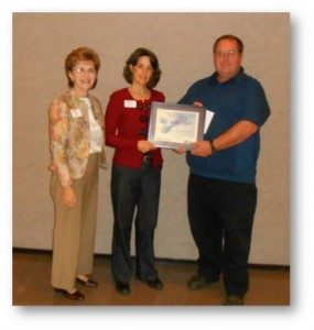 December 12, 2014 'Leadership and Service Recognition Award' recipient Robert B. Furr, CED Cabarrus County Award was presented by President-Elect Karee Mackey and accepted by Christine Barrier, Cabarrus Administrative Assistant and David Goforth, Cabarrus Agricultural Agent - Horticulture