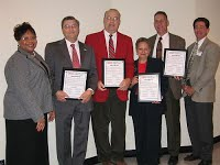 (L-R)Aggie Rogers, 2005 Federation President, Dr. Johnny Wynne,Dr. Jon Ort, Sheldia Sutton , representing Dr. Ray McKinnie, Dr. Joe Zublena and Ray Harris, Carteret County Extension Director, who made the presentation.