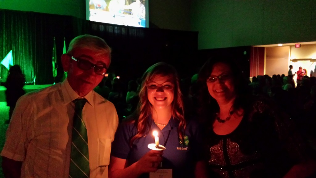 Sarah Thomas, pictured with parents Ms. Jean Bullis and Mr. Donnie Thomas, during the candlelight tapping ceremony for induction into the NC 4-H Honor Club.