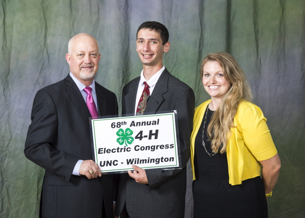Noble LaRocco Masi, pictured at center, receives a recruiting award from Duke Energy during the 68th annual 4-H Electric Congress. Also pictured: Mr. Wayne Huddleston, Account Manager with Duke Energy; Ginger Cunningham, 4-H Extension Agent in Chatham County.