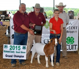 Rachel Murphy of Johnston County had the Grand Champion Doe. Pictured from left: Ricky Dewitt and Donnie Richardson, Richmond County Farm Bureau Board of Directors, Rachel Murphy, and Ted Clayton, Show Judge.