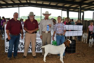 Paison Cain of Randolph County was the Intermediate 11-13 Showmanship Winner. Pictured from left: Donnie Richardson and Ricky Dewitt, Richmond County Farm Bureau Board of Directors, Ted Clayton, Show Judge, and Paison Cain.