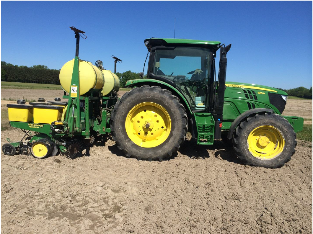 Standard tractor and planter ready for field operations.