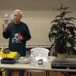 Extension Master Gardener Volunteer demonstrating seed starting.