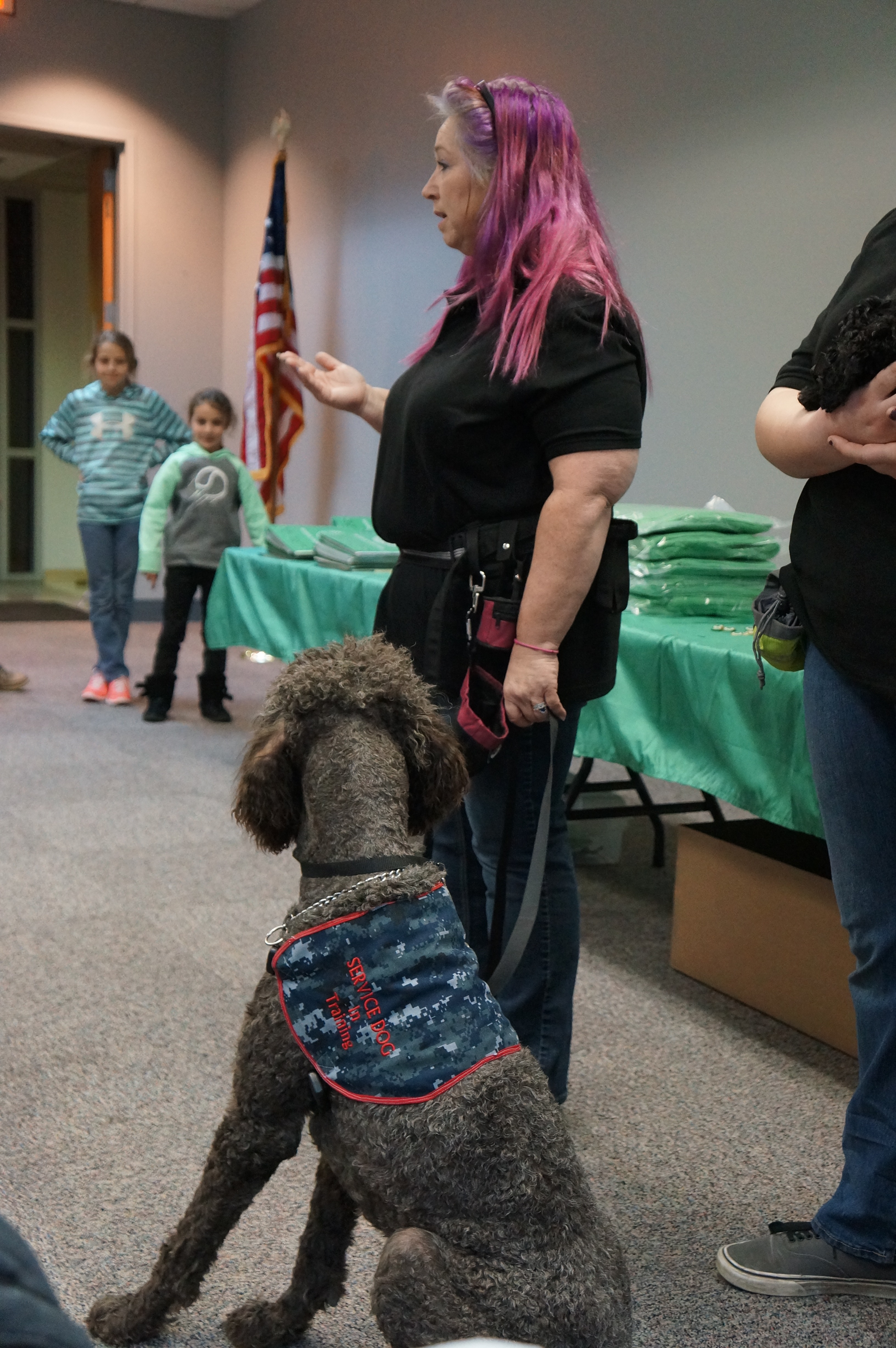 Service dog expert, Deborah Walo, demonstrates obedience with service dog.