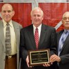 Picture of (from left to right) Lycurous Lowry (Robeson County Farm Bureau, President), Larry Wooten (North Carolina Farm Bureau, President), and Larry Locklear (Robeson County Crop Promotion Association, President)