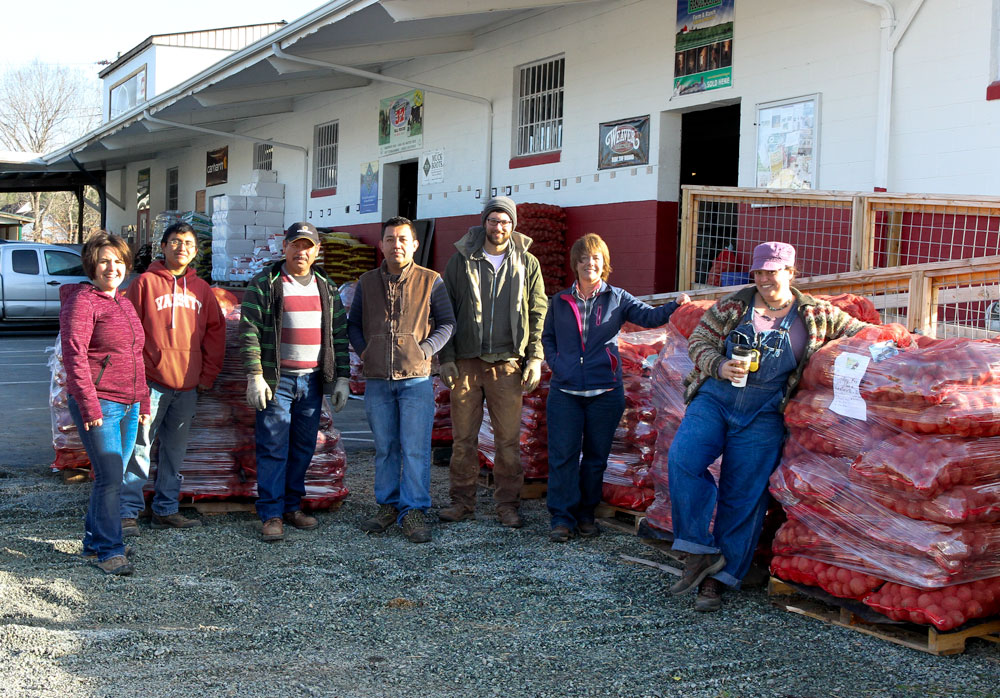 Country Farm & Home staff from left to right: owner Melinda Fitzgerald, Victor Sanchez, Ruben Esquivel, Antonio Carreno, Adam Sherwood, Fritzi Eckstein, and Hillary Heckler. Photo by Debbie Roos.