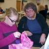 Mia and Ms. Claudia work on Mia's skirt for the 4-H Fashion Revue.