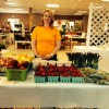 Carlee Hogan of Tarheel Produce displays her products at the 2015 Currituck County Home, Flower, and Garden Show