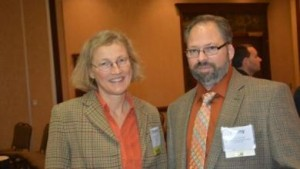 Christina Cowger, small grains pathologist at North Carolina State University, discusses scab control measures with Timmy Thomas, a Timberlake, N.C. farmer and first president of the North Carolina Small Grain Growers Association, during the North Carolina Commodities Conference in Durham. (photo from Southeast Farm Press)