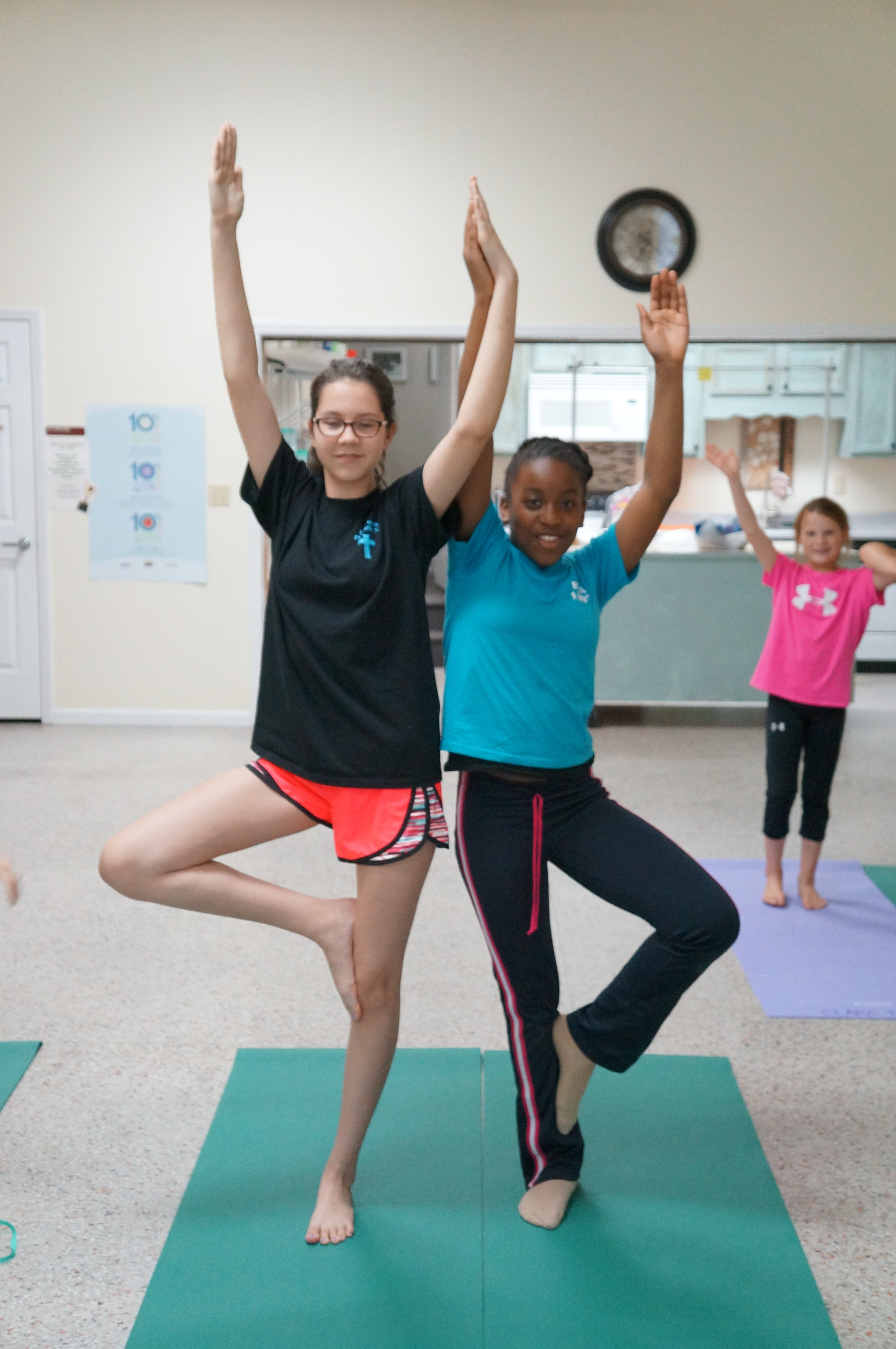 Emily Chandler and Keriah Bell show off a perfect Double Tree Pose during partner yoga class.