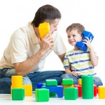 father and kid boy role-playing together isolated ** Note: Shallow depth of field