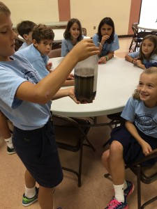 "Student at St. Egbert's School doing the ""soil shake"""