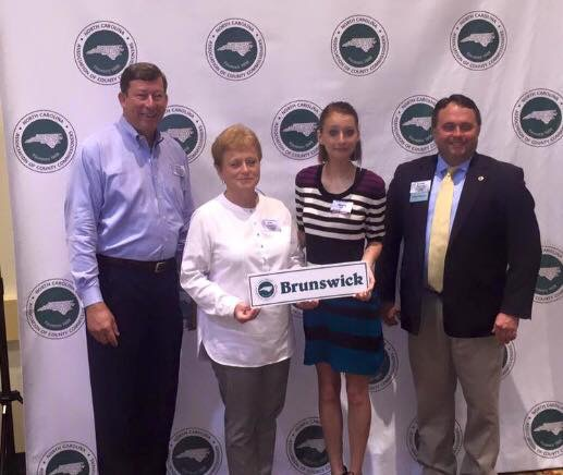 Alexis Apple with Brunswick County Commisioners