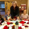 Kids and adults participate in the 4-H Bake-Off craft workshop