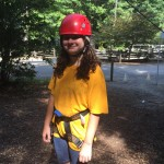 Road Runner 4-Her Kacey Field preparing to climb the rock wall.