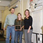 Shelby Emrich, Chamber Director, presents the Outstanding Agribusiness Award.