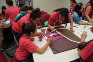 Juntos participants painting together