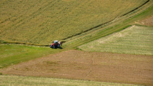 aerial shot of farmer tending to his fields
