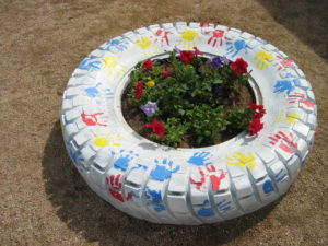 tire with a garden planted in the middle