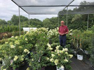 Mr. Brafford in greenhouse